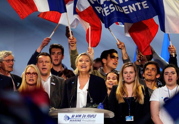 Marine Le Pen, French National Front (FN) political party leader and candidate for French 2017 presidential election, smiles to supporters at the end of a political rally in Bordeaux, France, April 2, 2017.  REUTERS/Regis Duvignau