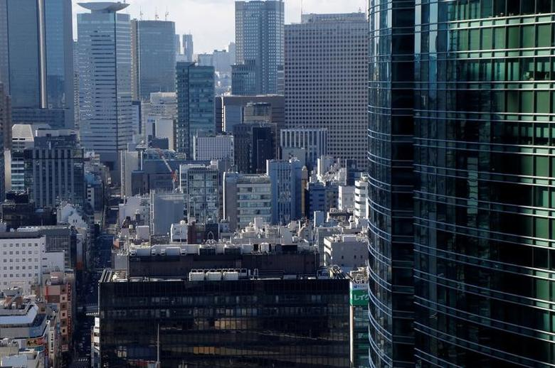 Office buildings are pictured at a business district in Tokyo, Japan, February 12, 2017. Picture taken February 12, 2017.  REUTERS/Toru Hanai - RTSYCZ7