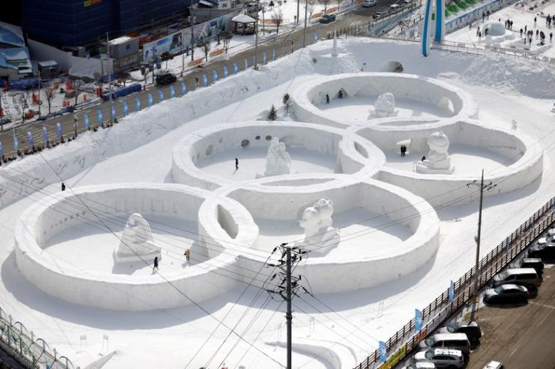 An ice sculpture of the Olympic rings is seen during the Pyeongchang Winter Festival, near the venue for the opening and closing ceremony of the PyeongChang 2018 Winter Olympic Games in Pyeongchang, South Korea, February 10, 2017.  REUTERS/Kim Hong-Ji