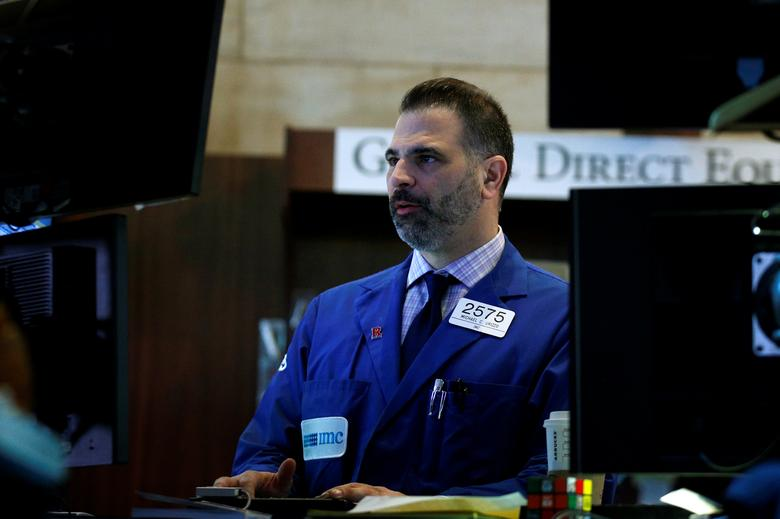 A specialist trader works at his post on the floor of the New York Stock Exchange (NYSE) in New York, U.S., March 30, 2017. REUTERS/Brendan McDermid