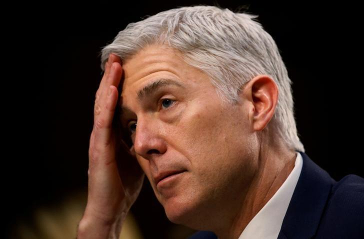 U.S. Supreme Court nominee judge Neil Gorsuch listens to a question as he testifies during the third day of his Senate Judiciary Committee confirmation hearing on Capitol Hill in Washington, U.S., March 22, 2017. REUTERS/Jim Bourg