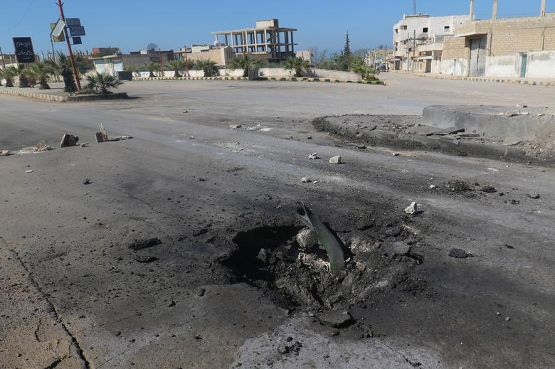 A crater is seen at the site of an airstrike, after what rescue workers described as a suspected gas attack in the town of Khan Sheikhoun in rebel-held Idlib, Syria. REUTERS/Ammar Abdullah