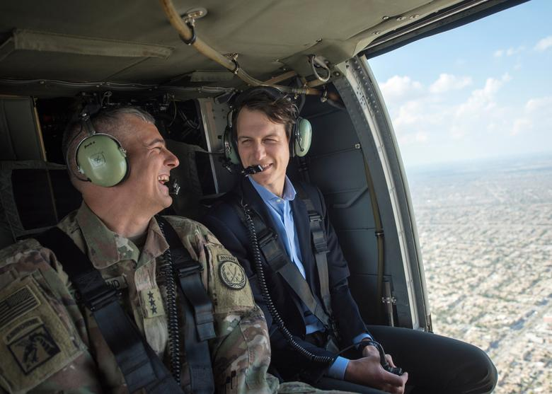 Jared Kushner (R), Senior Advisor to President Donald J. Trump, is pictured during a helicopter transit over Baghdad, Iraq, in this April 3, 2017 handout photo. Navy Petty Officer 2nd Class Dominique A. Pineiro/DoD/Handout via REUTERS