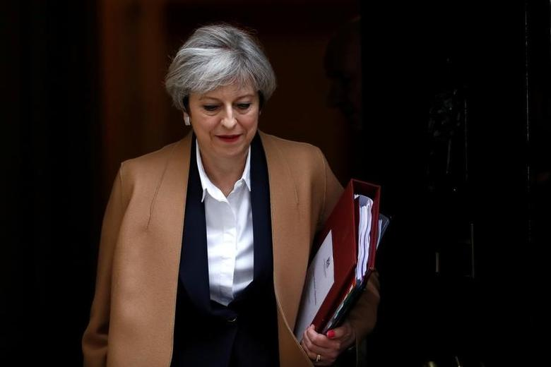 FILE PHOTO: Britain's Prime Minister Theresa May leaves 10 Downing Street in London, March 29, 2017. REUTERS/Stefan Wermuth