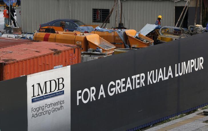 FILE PHOTO - Workmen are pictured on site at the 1 Malaysia Development Berhad (1MDB) flagship Tun Razak Exchange development in Kuala Lumpur, Malaysia, March 1, 2015.  REUTERS/Olivia Harris/File Photo