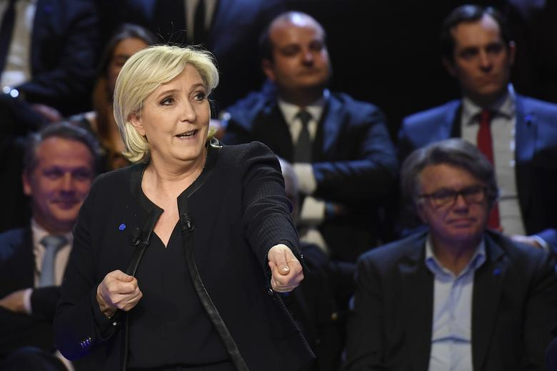 Marine Le Pen of French National Front (FN) attends a prime-time televised debate for the candidates at French 2017 presidential election in La Plaine Saint-Denis, near Paris, France, April 4, 2017.   REUTERS/Lionel Bonaventure/Pool
