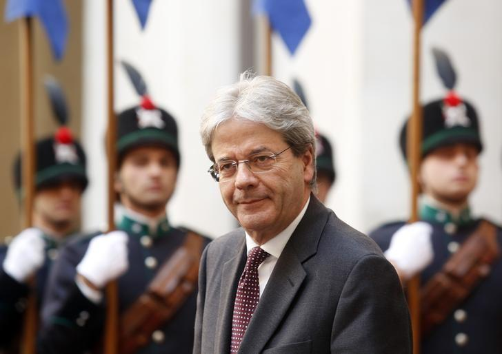 Italian Prime Minister Paolo Gentiloni looks on as he waits for the arrival of Britain's Prince Charles at Chigi Palace in Rome, Italy, April 5, 2017. REUTERS/Remo Casilli