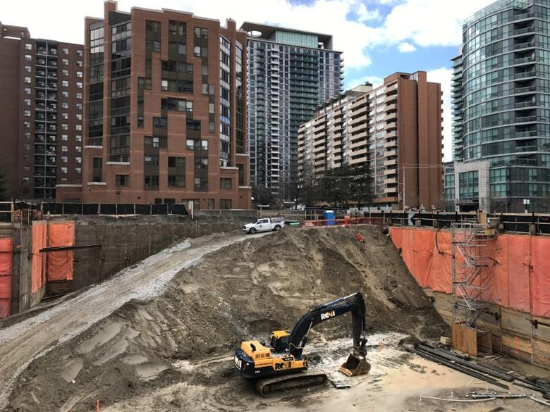 Construction equipment is parked at the bottom of a pit on the site of a new condominium complex off Redpath Avenue in Toronto, Ontario, Canada April 1, 2017.  REUTERS/Chris Helgren