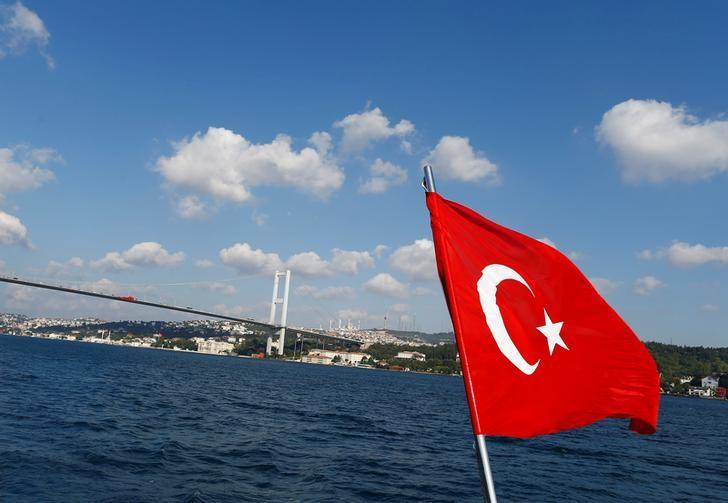 A Turkish flag is pictured on a boat with the Bosphorus bridge in the background in Istanbul, Turkey, August 6, 2016. REUTERS/Osman Orsal/Files