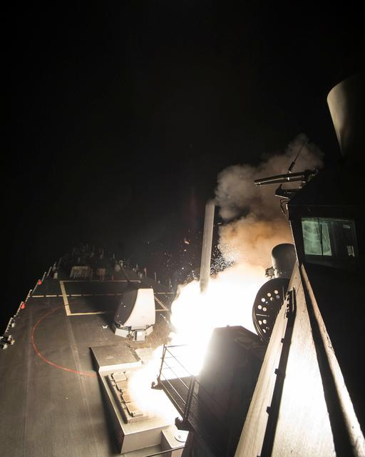 U.S. Navy guided-missile destroyer USS Ross (DDG 71) fires a tomahawk land attack missile in Mediterranean Sea on April 7, 2017.   Robert S. Price/Courtesy U.S. Navy/Handout via REUTERS