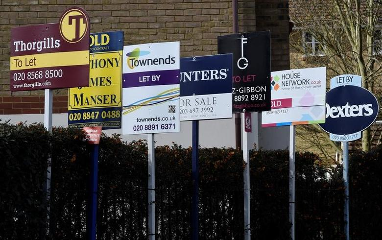 Property estate agent sales and letting signs are seen attached to railings in London, Britain, March 30, 2016. REUTERS/Toby Melville/File Photo