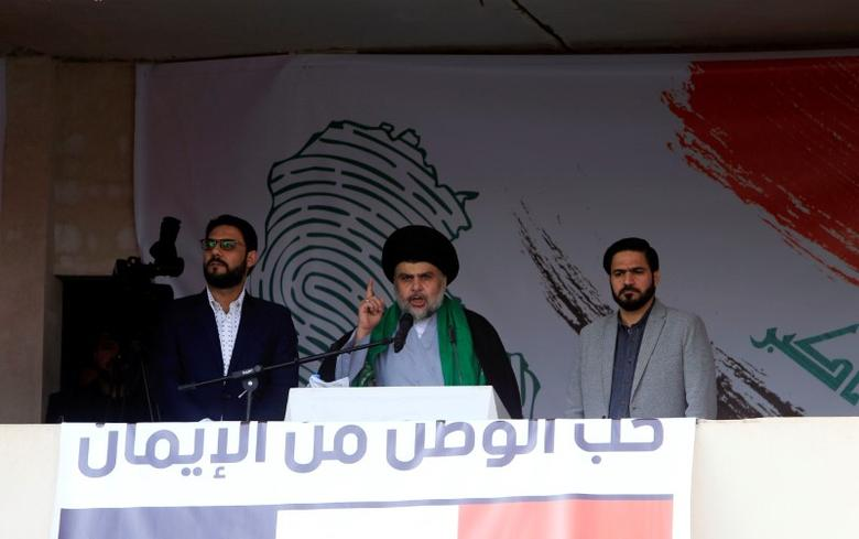 Iraqi Shi'ite cleric Moqtada al-Sadr speaks during a protest against corruption and informs his followers about his will at Tahrir Square in Baghdad, Iraq March 24, 2017. REUTERS/Alaa Al-Marjani