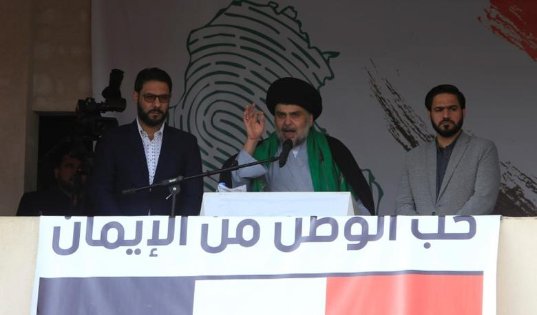 FILE PHOTO: Iraqi Shi'ite cleric Moqtada al-Sadr speaks during a protest against corruption and informs his followers about his will at Tahrir Square in Baghdad, Iraq March 24, 2017. REUTERS/Alaa Al-Marjani