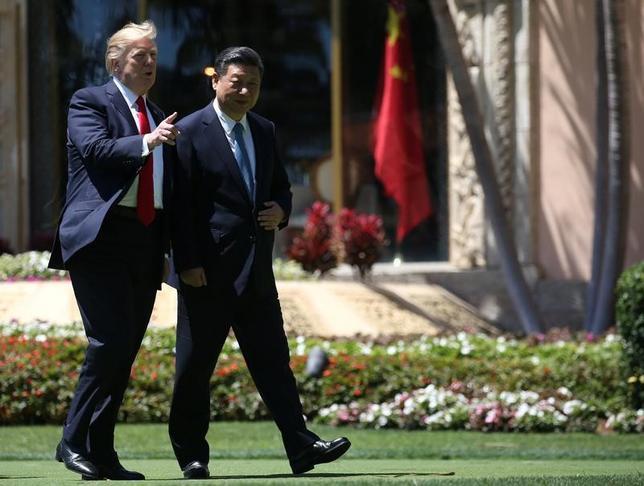 4月8日、中国国営メディアは、先の米中首脳会談について、両国の対立は不可避ではないことを世界に示したと称賛した。7日撮影(2017年 ロイター/Carlos Barria)