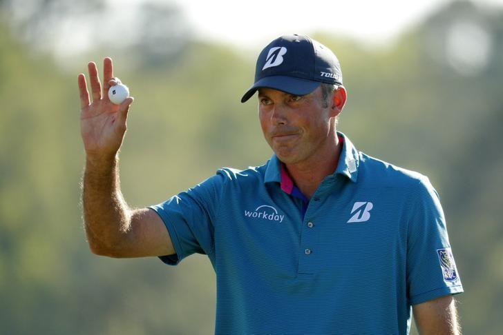 Matt Kuchar of the U.S. waves after finishing his final round play during the 2017 Masters golf tournament at Augusta National Golf Club in Augusta, Georgia, U.S., April 9, 2017. REUTERS/Brian Snyder