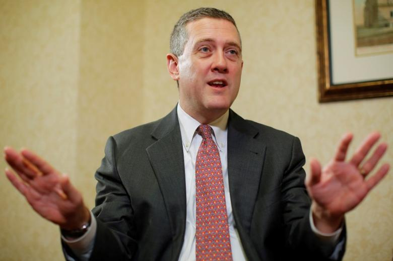 FILE PHOTO - James Bullard, President of the St. Louis Federal Reserve Bank, speaks during an interview with Reuters in Boston, Massachusetts, U.S. on August 2, 2013.   REUTERS/Brian Snyder/File Photo