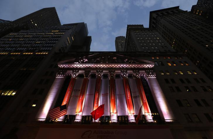 China's flag flies in front of the New York Stock Exchange before the initial public offering (IPO) of Alibaba Group Holding Ltd under the ticker ''BABA'' in New York September 19, 2014.      REUTERS/Lucas Jackson/Files