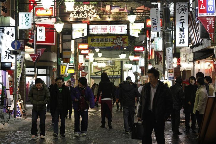 People walk through the Kokubuncho entertainment district in downtown Sendai, Miyagi prefecture, northeastern Japan February 25, 2012. REUTERS/Yuriko Nakao/File Photo