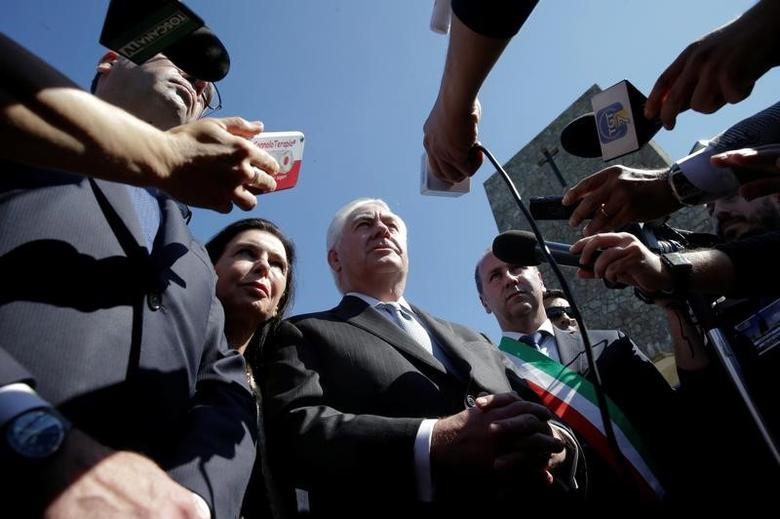 U.S. Secretary of State Rex Tillerson, (C) talks to reporters during a ceremony at the Sant'Anna di Stazzema memorial, dedicated to the victims of the massacre committed in the village of Sant'Anna di Stazzema by the Nazis in 1944 during World War II, Italy April 10, 2017. REUTERS/Max Rossi