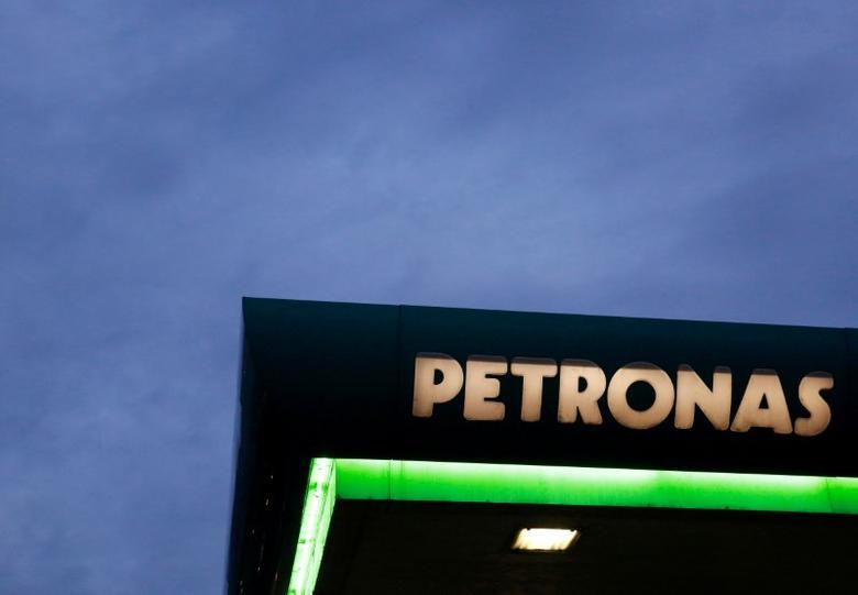 FILE PHOTO --  A logo of a Petronas fuel station is seen against a darkening sky in Kuala Lumpur, Malaysia February 10, 2016.     REUTERS/Olivia Harris/File photo