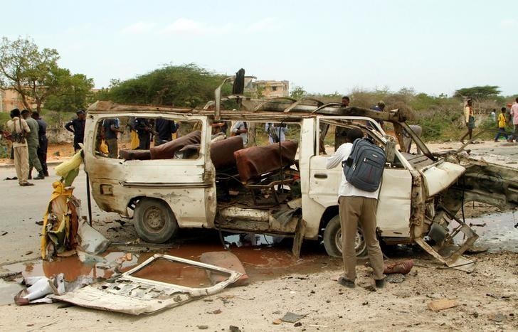 The wreckage of a minibus is seen at the scene of an explosion near a military base in Somalia's capital Mogadishu, April 9, 2017. REUTERS/Stringer
