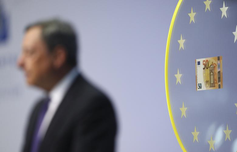 Mario Draghi, President of the European Central Bank (ECB) is pictured next to a new 50 Euro banknote during a news conference at the ECB headquarters in Frankfurt April 4, 2017. REUTERS/Kai Pfaffenbach
