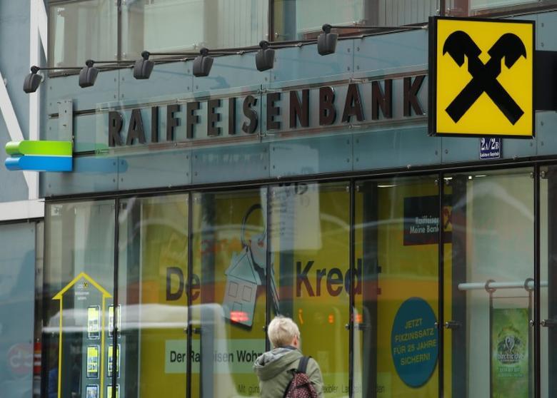 The logo of Raiffeisen Bank International is seen at a branch office in Vienna, Austria March 15, 2017. REUTERS/Heinz-Peter Bader
