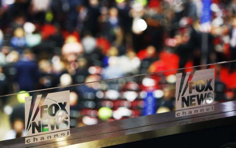 The logos of Fox News Channel are seen engraved on the glass of one of their booths at the Republican National Convention in Cleveland, Ohio, U.S. July 18, 2016.  REUTERS/Aaron P. Bernstein