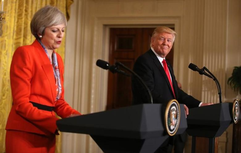 British Prime Minister Theresa May speaks as U.S. President Donald Trump looks on during their joint news conference at the White House in Washington, U.S., January 27, 2017.   REUTERS/Carlos Barria