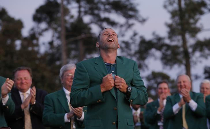 Sergio Garcia of Spain reacts after putting on his green jacket after winning the 2017 Masters golf tournament in a playoff at Augusta National Golf Club in Augusta, Georgia, U.S., April 9, 2017. REUTERS/Mike Segar