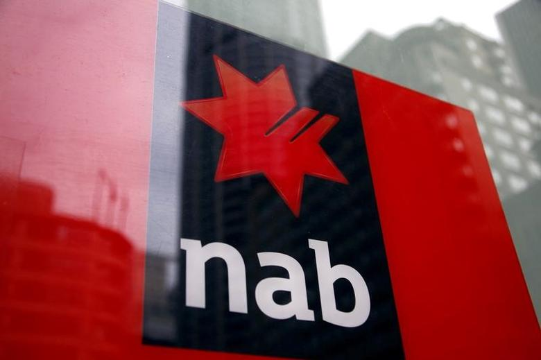 FILE PHOTO: A National Australia Bank (NAB) logo is pictured on an automated teller machine (ATM) in central Sydney September 12, 2014.   REUTERS/David Gray/File Photo