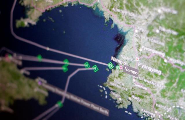 A Thomson Reuters Eikon ship-tracking screen shows cargo ships returning to Nampo port in North Korea April 11, 2017.   REUTERS/Thomas White/Illustration