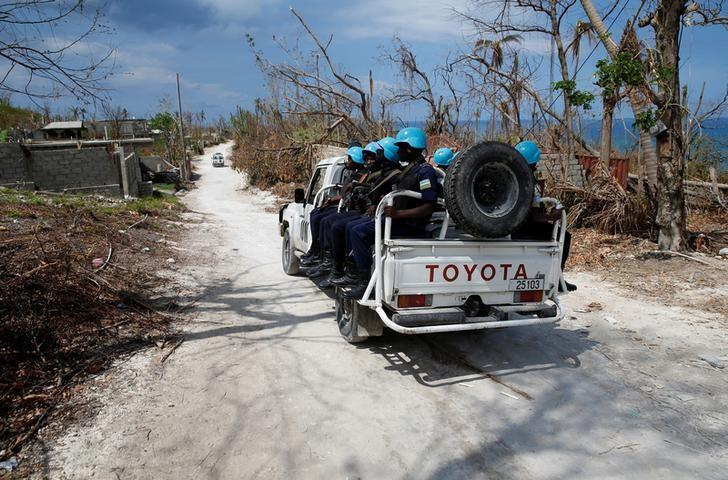 A pick up truck with U.N. peacekeepers patrol an area affected by Hurrican Matthew in Jeremie, Haiti, October 13, 2016. REUTERS/Carlos Garcia Rawlins