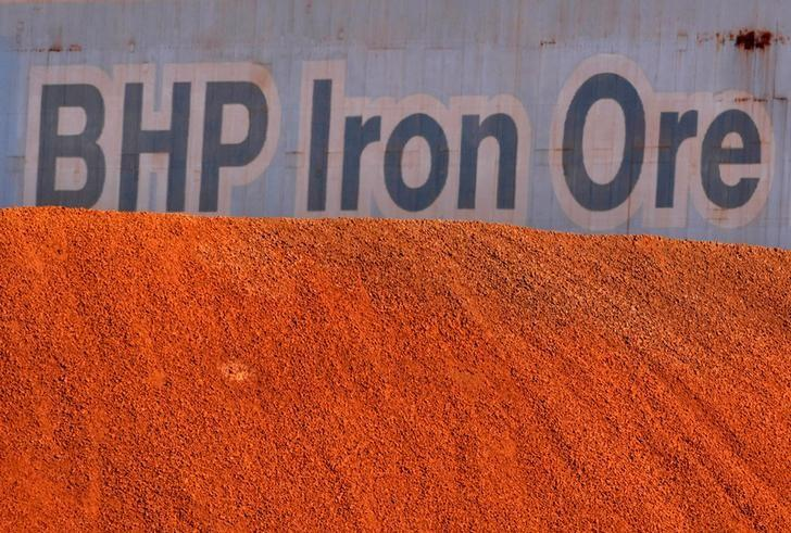 FILE PHOTO:  A BHP Billiton sign is visible behind a pile of iron ore at the company's loading facility in Port Hedland, Australia, May 30, 2008.       REUTERS/Tim Wimborne/File Photo