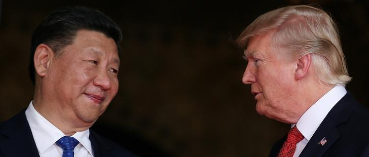 FILE PHOTO: U.S. President Donald Trump welcomes Chinese President Xi Jinping at Mar-a-Lago state in Palm Beach, Florida, U.S., April 6, 2017.  REUTERS/Carlos Barria/File Photo