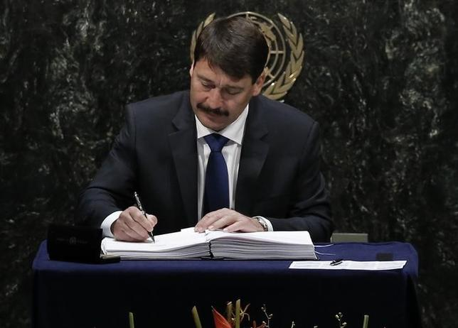 Hungarian President Janos Ader signs the Paris Agreement on climate change at the United Nations Headquarters in Manhattan, New York, U.S., April 22, 2016.  REUTERS/Mike Segar/Files