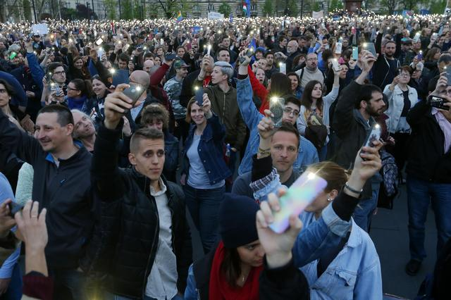 People light with their mobile phones as they protest against the bill that would undermine Central European University, a liberal graduate school of social sciences founded by U.S. financier George Soros in Budapest, Hungary, April 9, 2017. REUTERS/Laszlo Balogh