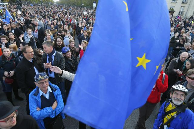 People hold European Union flag during a protest in Heroes' square against a new law that would undermine Central European University, a liberal graduate school of social sciences founded by U.S. financier George Soros in Budapest, Hungary, April 12, 2016. REUTERS/Laszlo Balogh