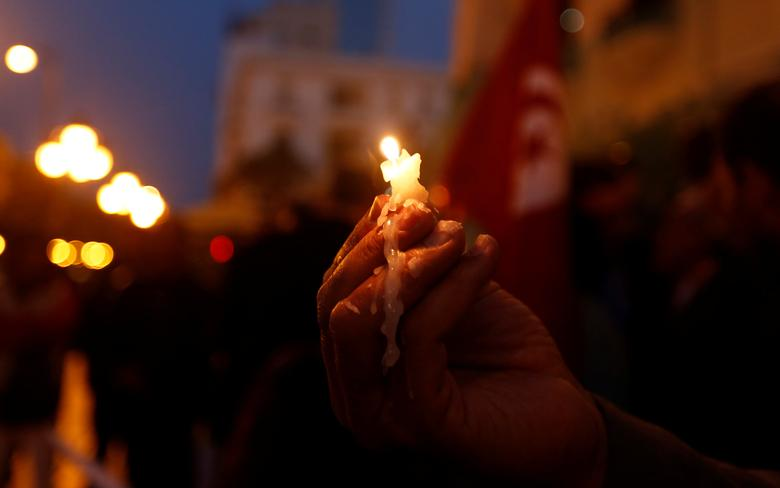 A man holds a candle as they protest against the twin attacks on Christian churches in Egypt, in Tunis,Tunisia April 10, 2017. REUTERS/Zoubeir Souissi
