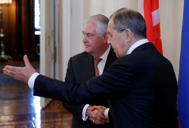 Russian Foreign Minister Sergei Lavrov shakes hands with U.S. Secretary of State Rex Tillerson during their meeting in Moscow, Russia, April 12, 2017.  REUTERS/Maxim Shemetov