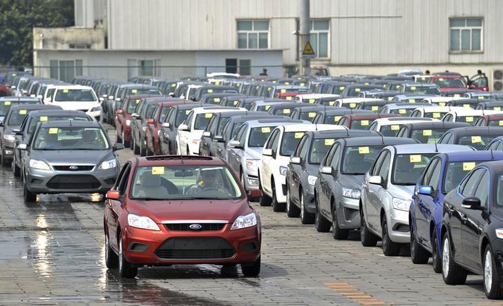 FILE PHOTO - Employees drive newly assembled Ford cars into the parking lot of a Ford manufacturing plant in Chongqing municipality April 20, 2012. REUTERS/Stringer