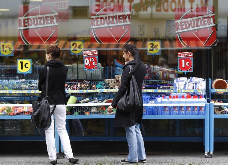 FILE PHOTO - Women inspect a shop with reduced goods in the western city of Herne September 11, 2012.  REUTERS/Ina Fassbender