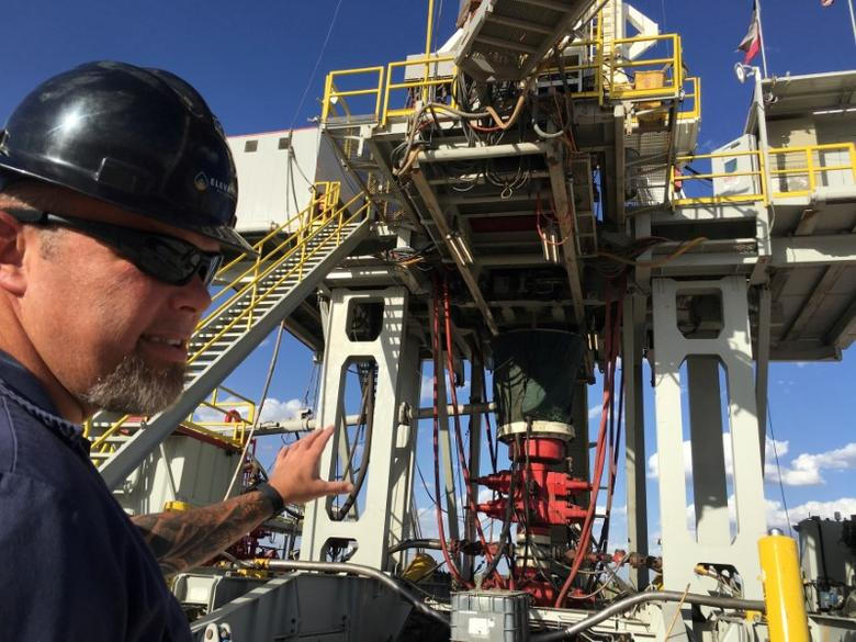 FILE PHOTO: Rig supervisor David Crow shows off the oil rig he manages foreElevation Resources at the Permian Basin drilling site in Andrews County, Texas, U.S.  in this photo taken May 16, 2016. REUTERS/Ann Saphir/File Photo