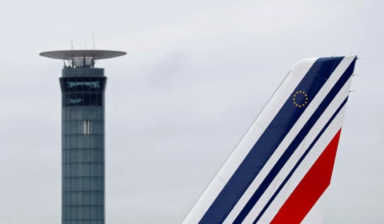The tail of an Air France airplane is seen as it taxies past a control tower at the Charles-de-Gaulle airport in Roissy during an air traffic controller strike, near Paris, France, March 7, 2017. REUTERS/Christian Hartmann