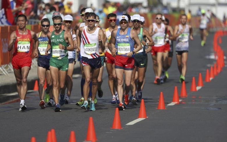FILE PHOTO: 2016 Rio Olympics - Athletics - Final - Men's 50km Race Walk - Pontal - Rio de Janeiro, Brazil - 19/08/2016. Athletes compete.   REUTERS/Damir Sagolj