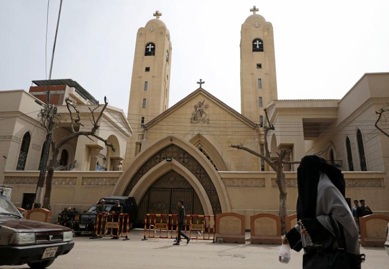 A woman passes in front of the Coptic church that was bombed on Sunday in Tanta, Egypt, April 10, 2017. REUTERS/Mohamed Abd El Ghany