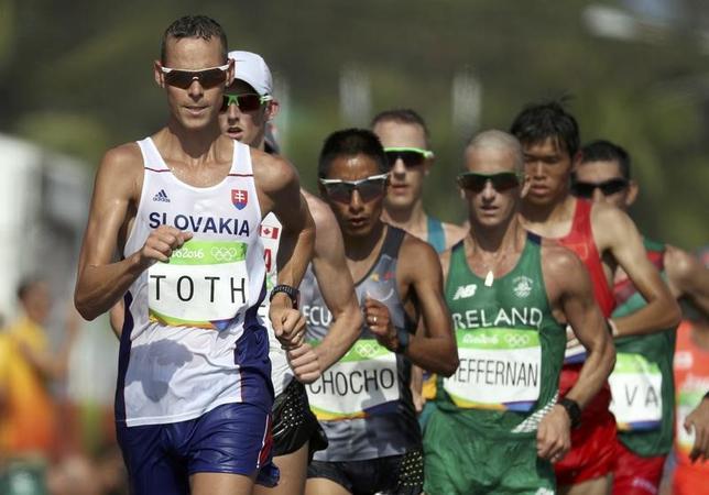 4月13日、国際陸連(IAAF)は、ロンドン開かれた理事会で、除外が懸念されていた男子50キロ競歩を2020年東京大会の五輪種目として継続することを決定した。2016年8月リオ五輪にて撮影(2017年 ロイター/Damir Sagolj)