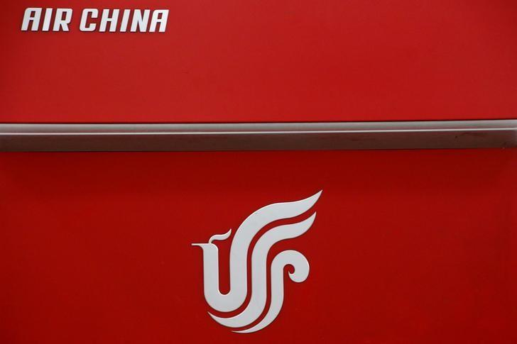 FILE PHOTO: Air China's logo is seen on a counter of Air China at a terminal of Beijing Capital International Airport in Beijing, China, March 28, 2016.REUTERS/Kim Kyung-Hoon/File Photo