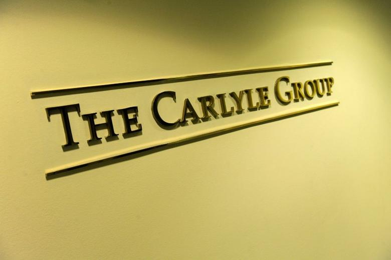 FILE PHOTO: A general view of the lobby outside of the Carlyle Group offices in Washington, U.S. May 3, 2012. REUTERS/Jonathan Ernst/File Photo