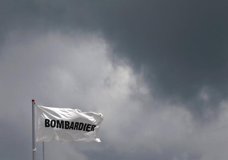 A Bombardier flag flutters amidst storm clouds at the Singapore Airshow at Changi Exhibition Center February 18, 2016.  REUTERS/Edgar Su/Files